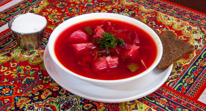A bowl of richly colored, tasty looking borscht